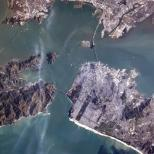 """""""The Golden Gate Bridge from space, and if you look closely, its shadow."""""""