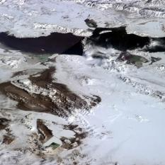 """Great Salt Lake and the Bonneville Salt Flats, Salt Lake City just visible. Dry powder downhill skiing, too."""