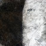 """""""A snowstorm left a clear divide in the Southwestern US in January. A natural yin and yang on the prairie."""""""